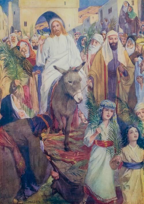 Jeesus ratsastaa Jerusalemiin.